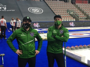 Team Saskatchewan's skip Matt Dunstone (left) and lead Dustin Kidby on the ice at WinSport ahead of the 2021 Brier. (Supplied: Team Saskatchewan)