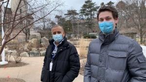Dr. Santohk Dhillon, paediatric cardiologist (left) and Logan Quinn outside the IWK Health Centre in Halifax. (CTV ATLANTIC / HEIDI PETRACEK)