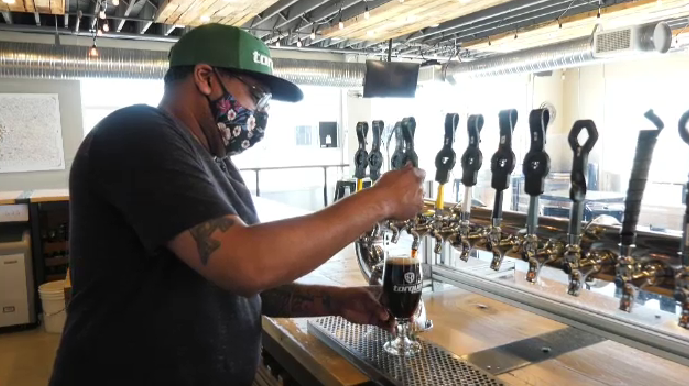 Sales Manager Raj Maniar pouring a beer at Torque Brewery on March 5, 2021.