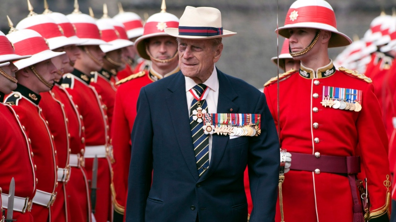 Prince Philip inspects an honour guard from the 3rd Battalion of The Royal Canadian Regiment at the Ontario Legislature in Toronto on Saturday April 27, 2013. THE CANADIAN PRESS/Frank Gunn