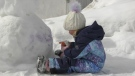 Ellie Rivest, 3, decorating her snowman on March 6. (Alana Pickrell/CTV News Northern Ontario)