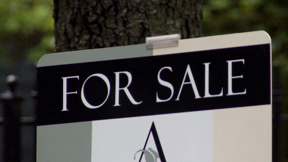 A for sale sign on a house.