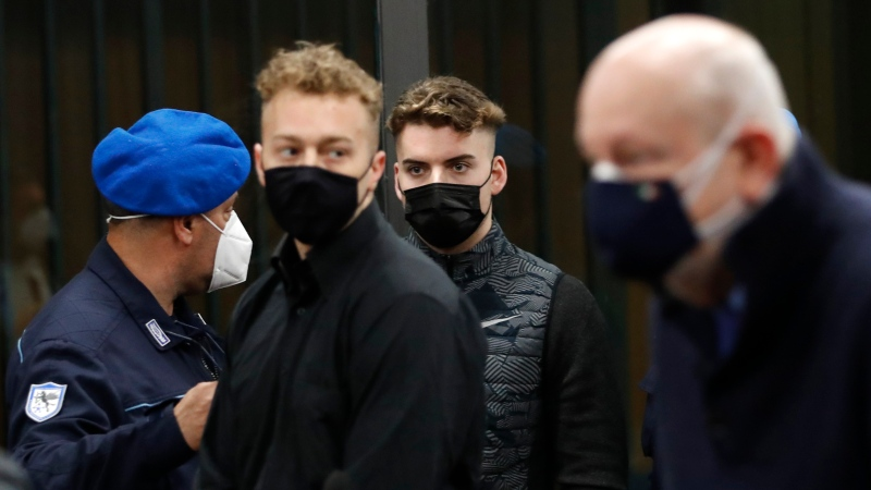 Gabriel Natale-Hjorth, right, and Finnegan Lee Elder, both from the United States, arrive for a hearing in the trial where they are accused of slaying the Carabinieri paramilitary police officer Mario Cerciello Rega, while on vacation in Italy in July 2019, in Rome, Saturday, March 6, 2021.(AP Photo/Alessandra Tarantino, Pool)