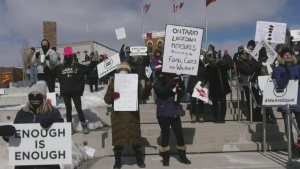 Demonstrators at Meridian Place in Barrie, Ont. call for changes to lockdown measures on Sat. March 6, 2021 (Rob Cooper/CTV News)