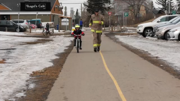 Calgary firefighter runs in full gear to raise money, awareness for sick friend