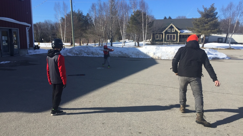 Members of the Central Ontario Reds practice bunting and base running on Sat. March 6, 2021 in New Lowell, Ont. (Steve Mansbridge/CTV News)
