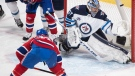 Montreal Canadiens' Brendan Gallagher (11) scores against Winnipeg Jets goaltender Connor Hellebuyck during second period NHL hockey action in Montreal, Saturday, March 6, 2021. THE CANADIAN PRESS/Graham Hughes