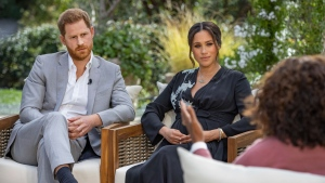 This image provided by Harpo Productions shows Prince Harry, left, and Meghan, Duchess of Sussex, in conversation with Oprah Winfrey. (Joe Pugliese/Harpo Productions via AP, File)