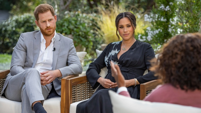 "This image provided by Harpo Productions shows Prince Harry, left, and Meghan, Duchess of Sussex, in conversation with Oprah Winfrey. ""Oprah with Meghan and Harry: A CBS Primetime Special"" airs March 7, 2021. (Joe Pugliese/Harpo Productions via AP, File)"