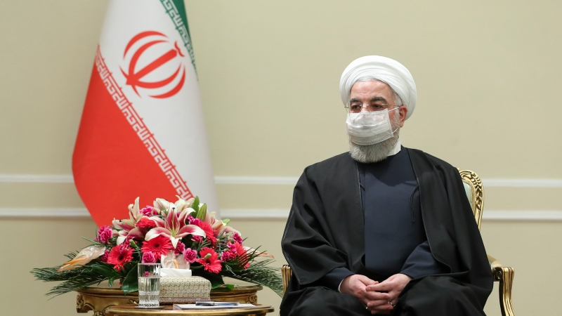 In this photo released by the official website of the office of the Iranian Presidency, President Hassan Rouhani meets with Irish Foreign Minister Simon Coveney, in Tehran, Iran, Sunday, March 7, 2021. Rouhani said Sunday his country is prepared to take steps to live up to measures in the 2015 nuclear deal with world powers as soon as the United States lifts economic sanctions on Iran (Iranian Presidency Office via AP)