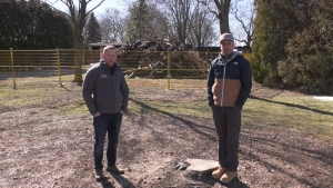 (L-R) Chris Oyler and Leo Munisteri stand in the 800 block of Old Tecumseh Road in Lakeshore, Ont. seen on Sunday March 06, 2021 (Alana Hadadean/CTV News)