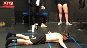 Nick Anapolsky seen with his chest on the ground as he attempted to set a world record for number of burpees in an hour. (Johnny Mazza / CTV Kitchener)