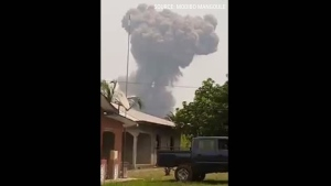 Huge plume of smoke rises after blast in Equatorial Guinea. (Source: Reuters via MODIBO MANGOULE)