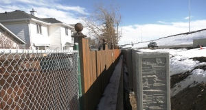 A concrete wall, meant to block out construction and traffic noise, is not very effective Valley Ridge residents say.