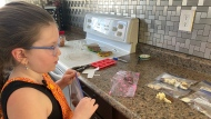 Sierra Antosh, 9, is raising money for Diabetes Canada by selling chocolates. (Cole Davenport / CTV News Regina)