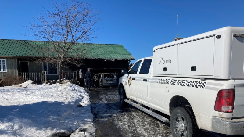 Investigators with the Ontario Fire Marshal's Office at the scene of a fatal fire in Ramara Twp, Ont. on Sun. March 7, 2021 (Ontario Fire Marshal/Twitter)