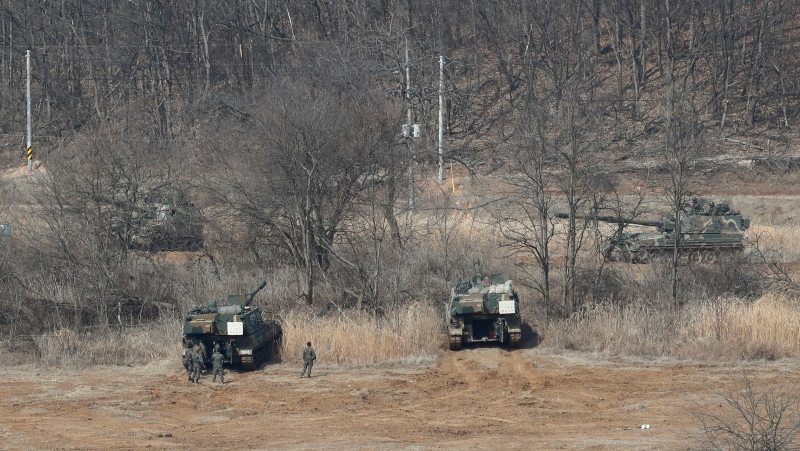 South Korean army K-9 self-propelled howitzers take positions in Paju, South Korea, near the border with North Korea, March 7, 2021. (AP Photo/Ahn Young-joon)
