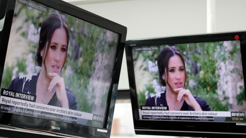 Australian television news in Sydney reports on an interview of the Duke and Duchess of Sussex by Oprah Winfrey, on March 8, 2021. (Rick Rycroft / AP)