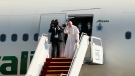 Pope Francis, font right, bids farewell upon concluding his visit to Iraq at Baghdad airport, Iraq, Monday, March 8, 2021. Pope Francis left Baghdad on Monday after three days of the historic whirlwind tour of Iraq that sought to bring hope to the country's marginalized Christian minority with a message of coexistence, forgiveness and peace. (AP Photo/Khalid Mohammed)