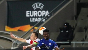 Slavia's Jan Boril, left, and Leicester's Daniel Amartey, right, head for the ball for the ball during the UEFA Europa League round of 32 first leg soccer match between AC Sparta Praha and Leicester City in Prague, Czech Republic, Thursday, Feb. 18, 2021. (AP Photo/Petr David Josek)