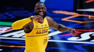 Los Angeles Lakers forward LeBron James smiles during the first half of basketball's NBA All-Star Game in Atlanta, Sunday, March 7, 2021. (AP Photo/Brynn Anderson)