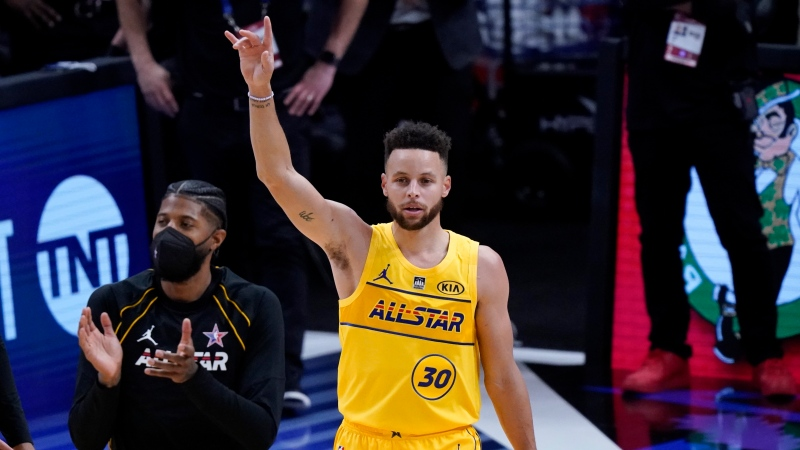 Golden State Warriors guard Stephen Curry celebrates after basketball's NBA All-Star Game in Atlanta, Sunday, March 7, 2021. (AP Photo/Brynn Anderson)