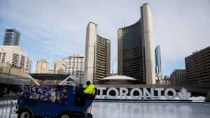 A Toronto city worker operates a Zamboni on the skating rink outside of Toronto City Hall on Saturday, Feb. 29, 2020. THE CANADIAN PRESS/Cole Burston