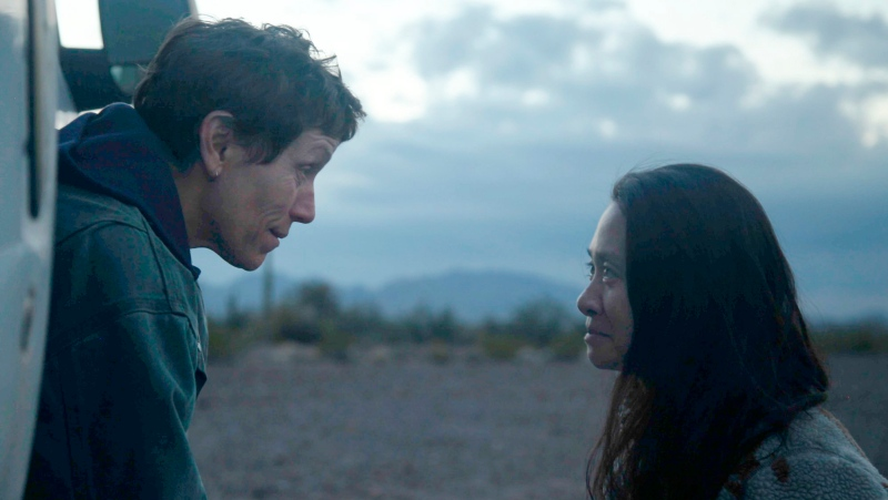 "This image released by Searchlight Pictures shows Frances McDormand, left, and director Chloe Zhao on the set of ""Nomadland."" (Searchlight Pictures via AP)"