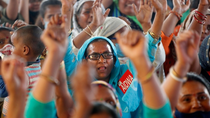 Indian female farmers and members of different women's NGOs shout slogans at the site of ongoing protests by farmers in Ghazipur, Delhi-Uttar Pradesh border, near New Delhi, India, on March 8, 2021. (Manish Swarup / AP)