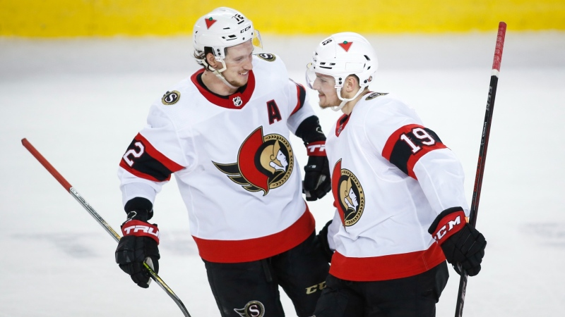 Ottawa Senators' Drake Batherson, right, celebrates his game-winning goal with teammate Thomas Chabot during shoot out NHL hockey action against the Calgary Flames in Calgary, Sunday, March 7, 2021.THE CANADIAN PRESS/Jeff McIntosh