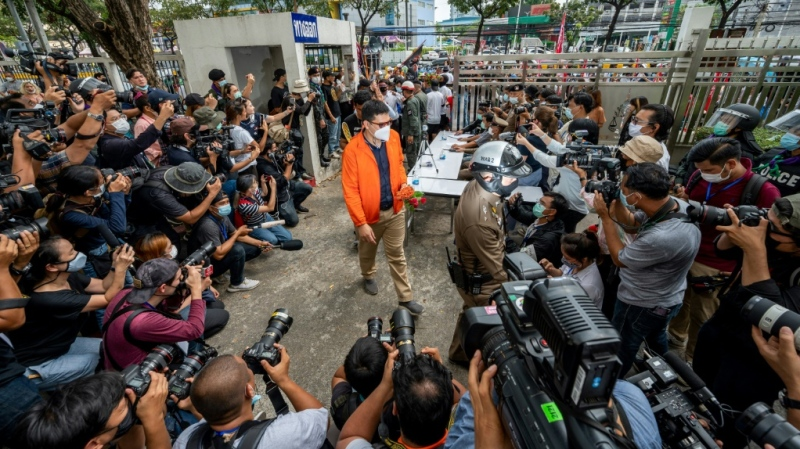 The activists marched to a Bangkok criminal court Monday morning flanked by scores of supporters carrying posters of other detained protest leaders and flags. (AFP)