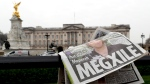 A newspaper is blown by the wind after it is placed on a railing by a television crew outside Buckingham Palace in London, on March 8, 2021. (Kirsty Wigglesworth / AP)