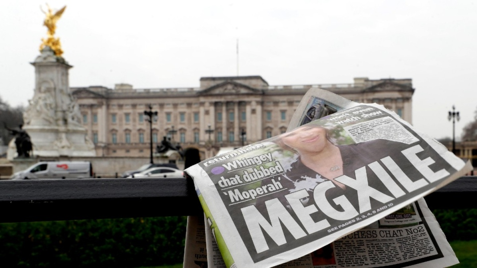 A newspaper is blown by the wind in London