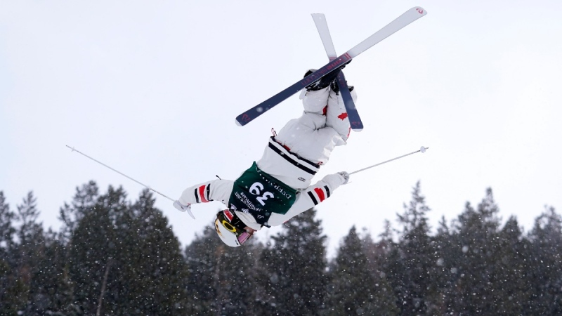 Mikael Kingsbury flies over a jump during qualifying at the World Cup men's freestyle moguls skiing competition in Deer Valley, Utah, on  Feb. 4, 2021. (Rick Bowmer / AP)