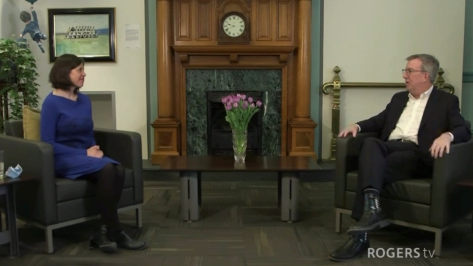 Dr. Vera Etches speaks with Mayor Jim Watson as part of the city's International Women's Day virtual celebration. (City of Ottawa YouTube page)