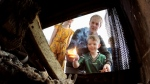The Durston family in Regina gathers around their fireplace a few times a week. The kids pitch in helping to build and light the fire. (Gareth Dillistone / CTV News Regina)