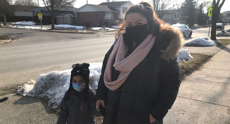 Claudia Baldizon is seen her with her youngest daughter, Melanie, in London, Ont. on Monday, March 8, 2021. Melanie was not a close contact of a case and is able to continue to go to school, while Baldizon's other two children are self-isolating after being told they were in close contact to a suspected case of COVID-19 at school. (Sean Irvine / CTV News)