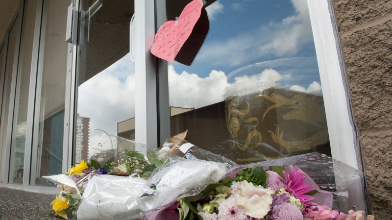 Flowers are seen at the front door of Dr. Denis Vincent's dental practice in North Vancouver, B.C. Tuesday, March 31, 2020. Dr. Denis Vincent was British Columbia's first community death from the novel coronavirus. THE CANADIAN PRESS/Jonathan Hayward