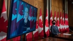 Prime Minister Justin Trudeau listens to Deputy Prime Minister and Minister of Finance Chrystia Freeland speak virtually during a news conference in Ottawa, on March 3, 2021. (Adrian Wyld / THE CANADIAN PRESS)