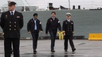 Prime Minister Justin Trudeau, Minister of National Defence Harjit Sajjan and Rear Admiral Art McDonald walk up to speak to media after meeting with members of the Canadian Forces at CFB Esquimalt in Esquimalt, B.C., on Thursday, March 2, 2017. THE CANADIAN PRESS/Chad Hipolito