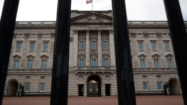Buckingham Palace, the official London residence of Britain's Queen Elizabeth II is seen through the rails of its fence in central London, Sunday, March 7, 2021. (AP Photo/Matt Dunham)