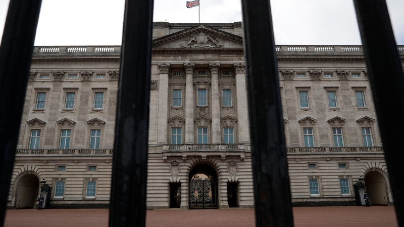 Buckingham Palace, the official London residence of Queen Elizabeth II is seen through the rails of its fence in central London, Sunday, March 7, 2021. (AP Photo/Matt Dunham)