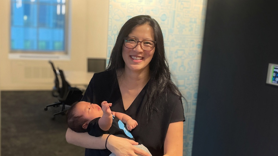 Faye Pang holds her son Kai in Xero's Toronto office. (Submitted)