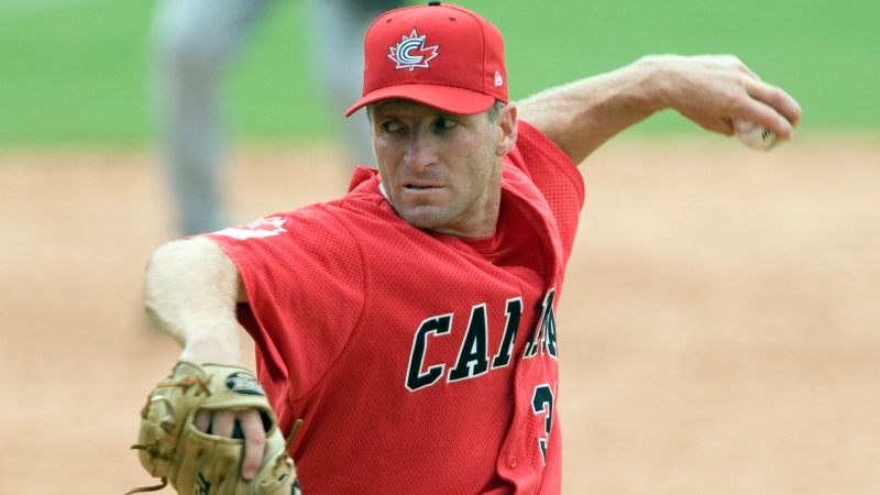 In this Aug. 13, 2008, file photo, Team Canada's Rheal Cormier pitches during the team's win over China in preliminary action at the Beijing Olympics in Beijing, China. Cormier, the durable left-hander who spent 16 seasons in the majors and remarkably pitched in the Olympics before and after his time in the big leagues, has died. He was 53. (Adrian Wyld/The Canadian Press)