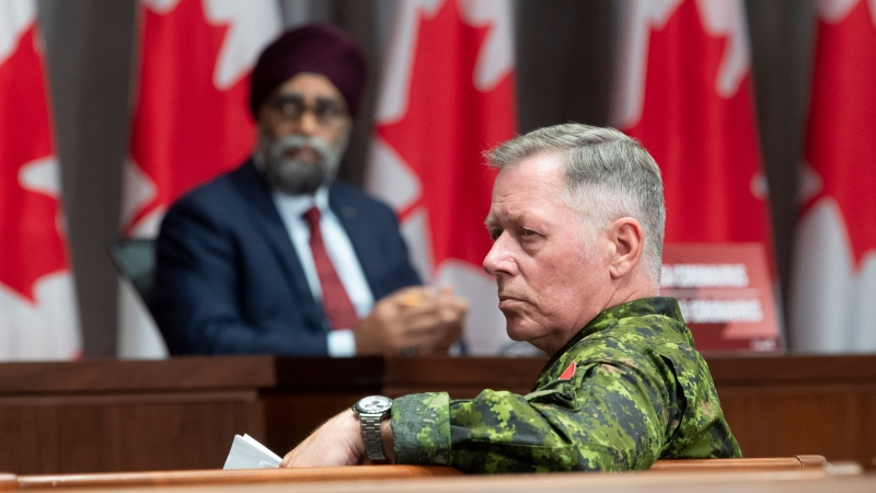 National Defence Minister Harjit Sajjan and Chief of Defence Staff Jonathan Vance listen to a question during a news conference Friday, June 26, 2020 in Ottawa. THE CANADIAN PRESS/Adrian Wyld