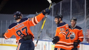 Edmonton Oilers' Connor McDavid (97), Leon Draisaitl (29) and Kyle Turris (8) celebrate a goal against the Ottawa Senators during second period NHL action in Edmonton on Monday, March 8, 2021. THE CANADIAN PRESS/Jason Franson