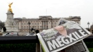A newspaper is blown by the wind after it is placed on a railing by a television crew outside Buckingham Palace in London, Monday, March 8, 2021.  (AP / Kirsty Wigglesworth)