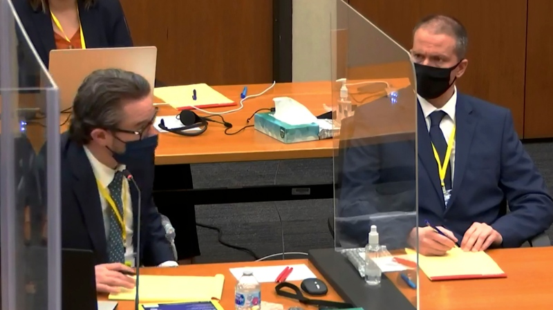 In this image from video, defense attorney Eric Nelson left, and defendant, former Minneapolis police officer Derek Chauvin, right, listen as Hennepin County Judge Peter Cahill presides over pretrial motions before jury selection Monday, March 8, 2021, in the trial of former officer Chauvin, in the May 25, 2020, death of George Floyd at the Hennepin County Courthouse in Minneapolis, Minn. (Court TV, via AP, Pool)