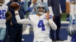Dallas Cowboys quarterback Dak Prescott throws a pass during warmups before an NFL football game in Arlington, Texas, on Oct. 11, 2020. (Ron Jenkins / AP)