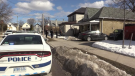 Police work at the scene of a death investigation in London, Ont. on Sunday, March 7, 2021. (Brent Lale / CTV News)